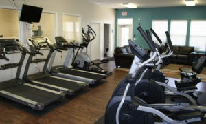 Fitness Room view with more aerobic equipment and view of entrance.