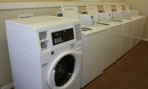 Laundry room with new washers and dryers at our Lawrence apartments.