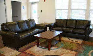 Living room space with two couches in our Lawrence KS apartments clubhouse