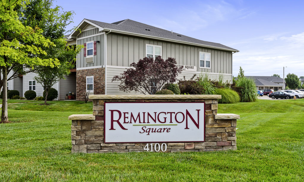 Entrance and sign at Remington Square apartments in Lawrence, KS